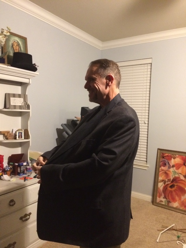 Man showing weight loss in oversized suit jacket